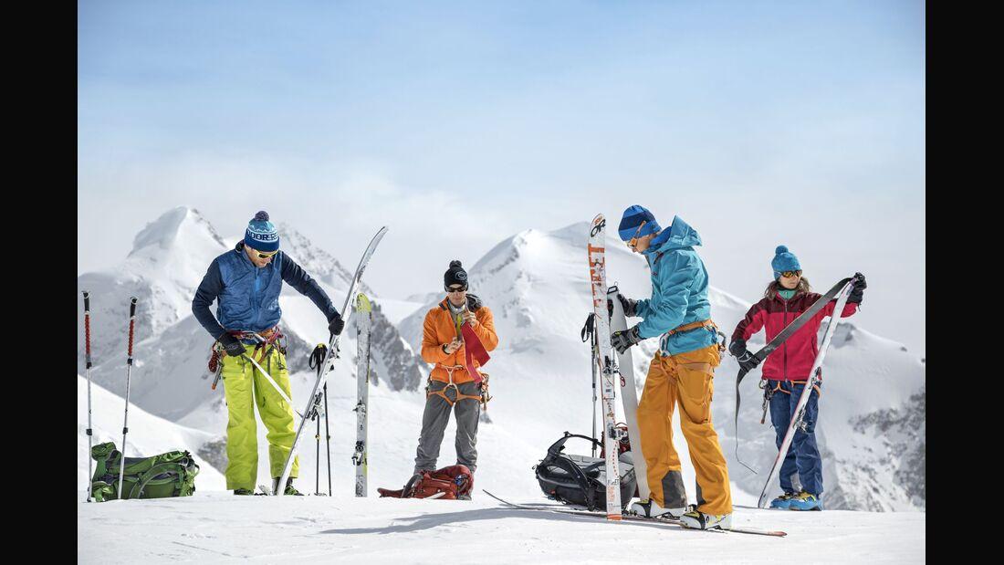 Backcountry skiers getting gear ready